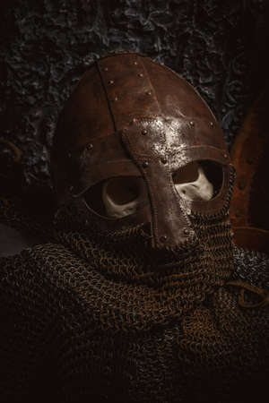 chain armour: Picture mans skull in the helmet on chain armour