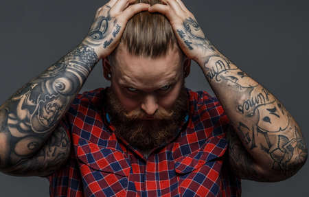 beefcake: Picture of brutal tattooed male with beard Stock Photo