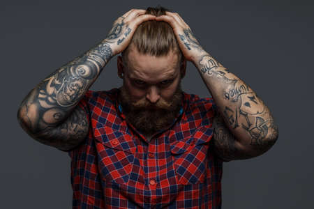 Picture of brutal tattooed male with beard Stockfoto