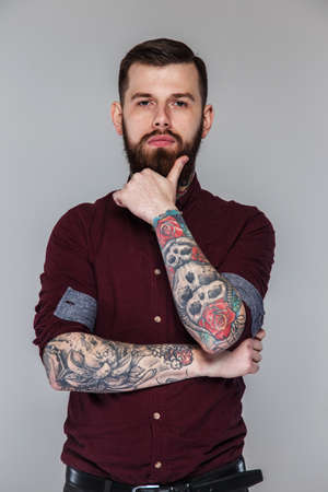 tattoed: Male with tattoed hands and beard posing