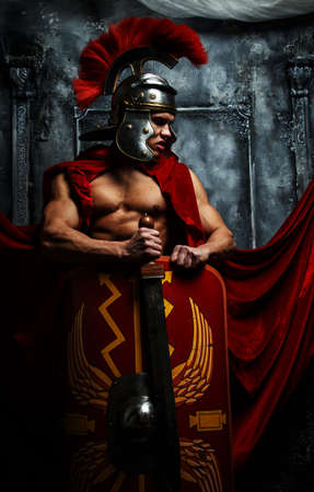 pectorals: Roman warrior with muscular body holding sword and shield
