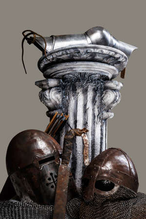 greek column: Picture of the antic greek column and two steel helmets abd sword