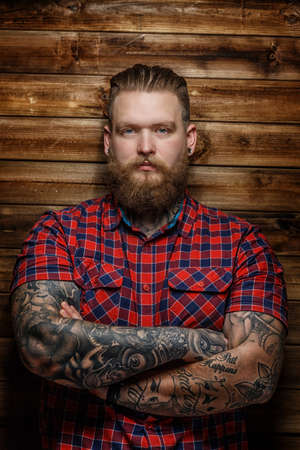 brutal: Huge brutal man with beard and tattooes Stock Photo