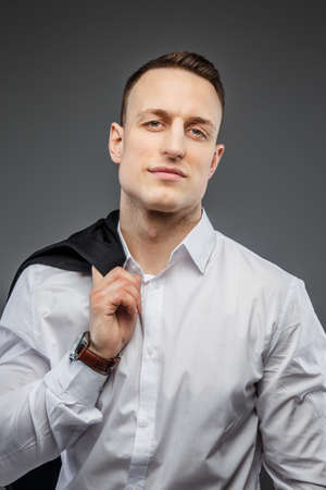 wrist watch: Portrait of handsome man in white shirt with wrist watch on his hand