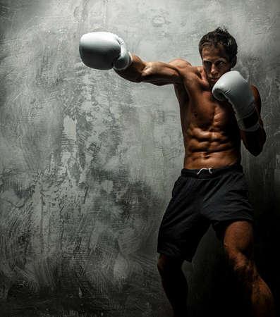 boy  naked: Awesome female with great antomy boxing. Grey background.