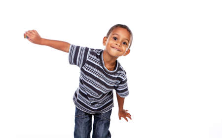 bambini: Felice nero bambino africano in studio isolato su bianco. Archivio Fotografico