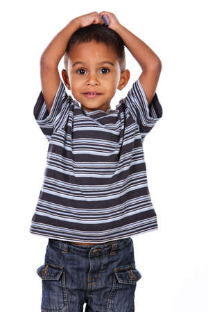 Happy black african child in studio isolated on white.