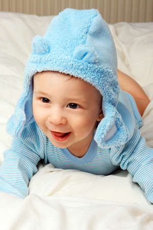 Cute cheerful  little baby boy in blue clothes. photo