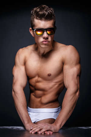 Portrait of awesome male model with naked muscular body