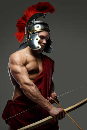 wounded: Wounded gladiator with bow isolated on grey. Stock Photo
