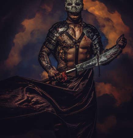 skull mask: Brutal dangerous tattooed medievel fighter in skull mask in armor