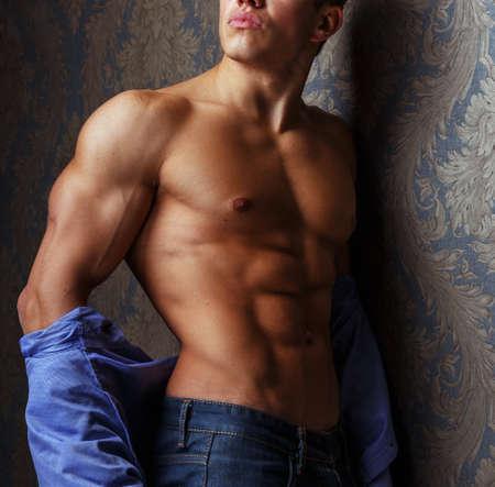 pectorals: Fashion portrait of man body in blue shirt.