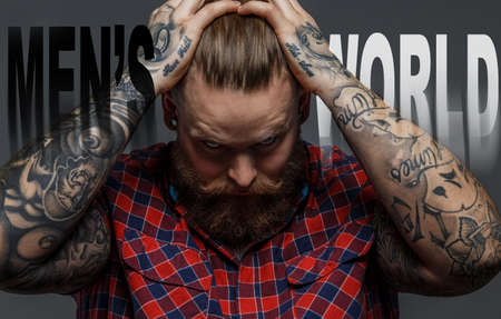 brutal: Picture of brutal tattooed male with beard Stock Photo