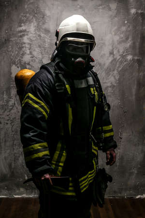 grey background: Firefighter in oxygen mask and axe on grey background.