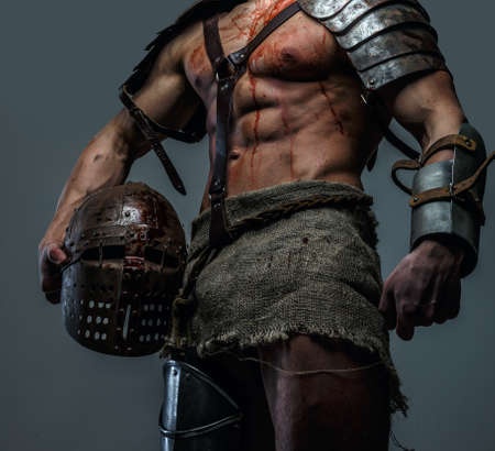 pectorals: Wounded gladiator standing and holding his helmet