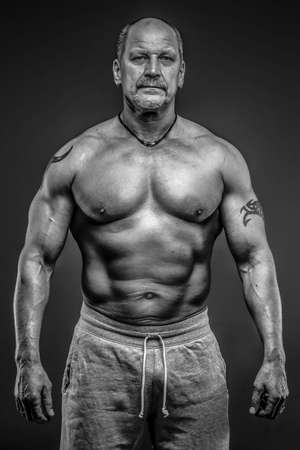 Middle age male with muscular body Stock Photo