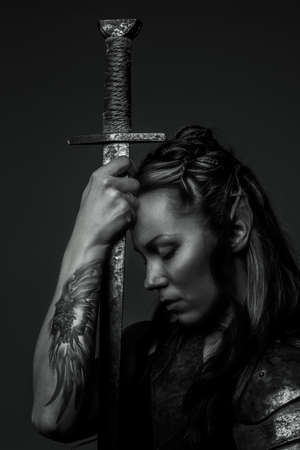 Elf woman with sword. Black and white photo