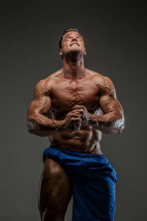 Emotional bodybuilder on grey background Stock Photo