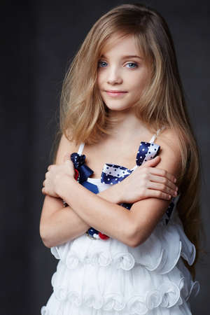 blue eyes: Portrait of young girl with blue eyes on dark background