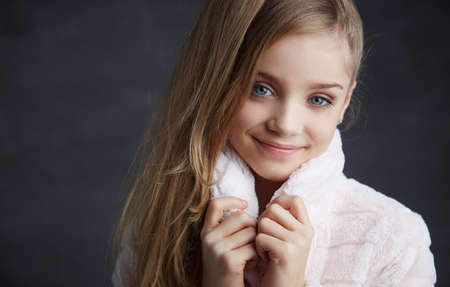 white coat: Portrait of young girl with blue eyes in white coat. Stock Photo