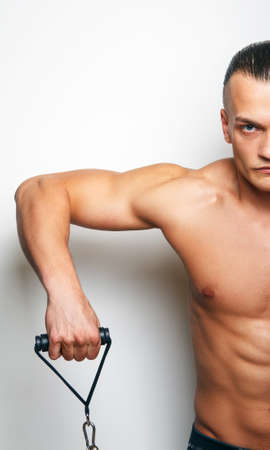 half body: Half body of muscular man witj expander Stock Photo