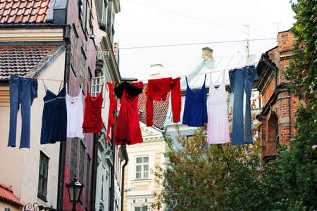 Colorful drying clothes on the old town street photo