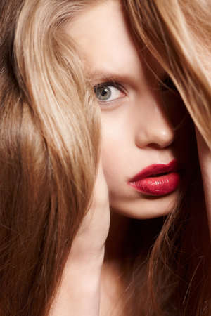 red haired woman: Portrait of red haired woman with red lips