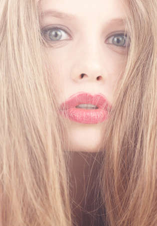 coloring lips: Emotional red hair woman with red lips Stock Photo