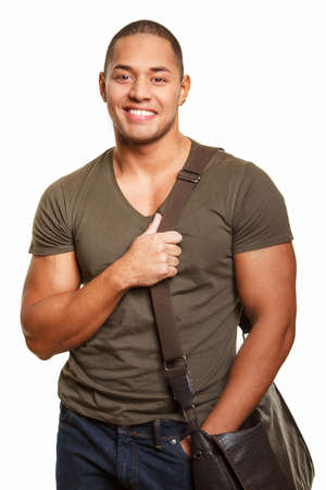good shirt: Good looking guy with bag  in jeans and t shirt isolated on white background