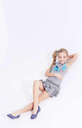 Cute girl posing in studio on white background
