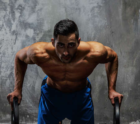 man power: Muscular shirtless guy posing in studio Stock Photo