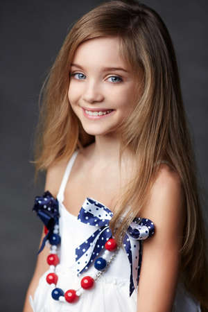 Portrait of beautiful child girl model with blue eyes.