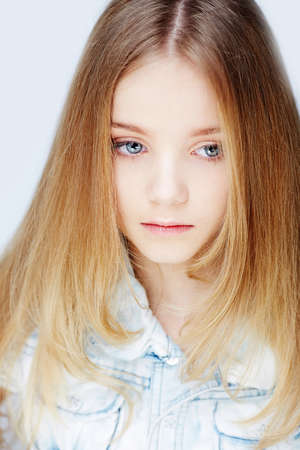 child model: Portrait of beautiful child girl model with blue eyes.