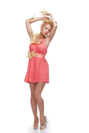 body image: Full body image of blond female in pink dress.