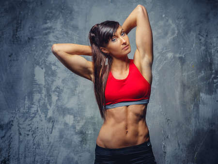 ginástica: Mulher da aptidão no sportswear.
