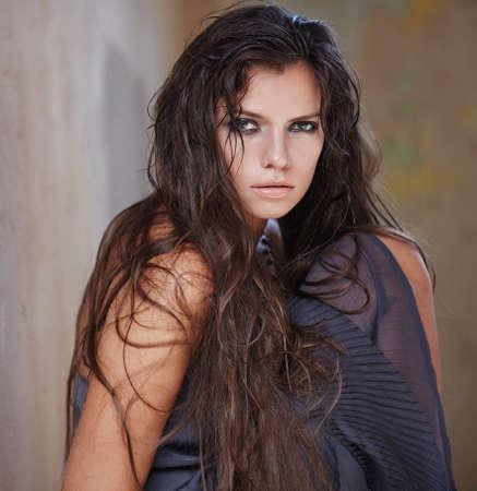 dark brown hair: Portrait of woman with long dark brown hair.