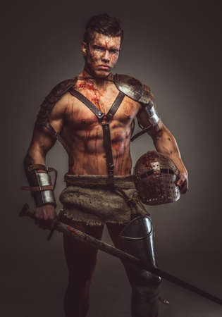 nipples: Muscular bloody gladiator with sword and helmet. Stock Photo