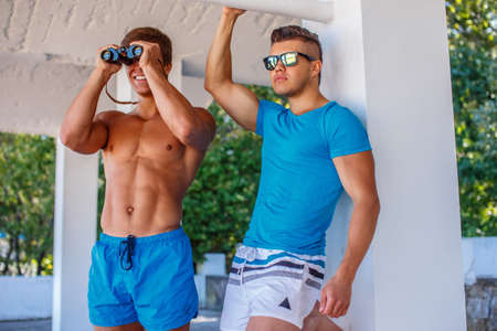 safeguard: Two awesome safeguard guys. One of them looking through binocular.