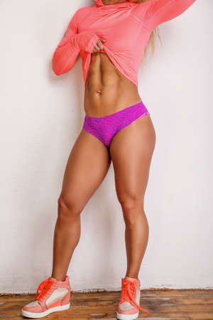 pink panties: Muscular female in violet panties and pink shirt.