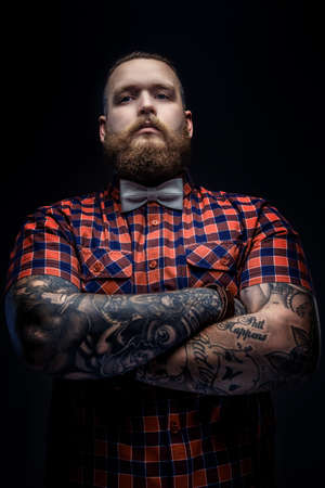 brutal: Brutal man with beard and tattooes on his arms.