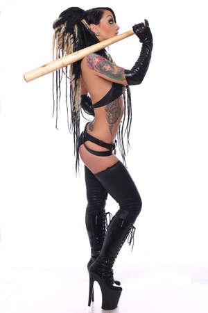 sadomasochism: Sexy emo girl in black underwear holds baseball bat. Isolated over white background.