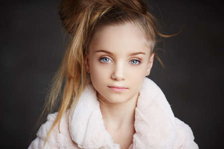 white coat: Horizontal portrait of young girl with blue eyes in white coat.