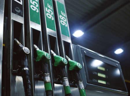 Green fuel pistols on fuel station. 스톡 콘텐츠