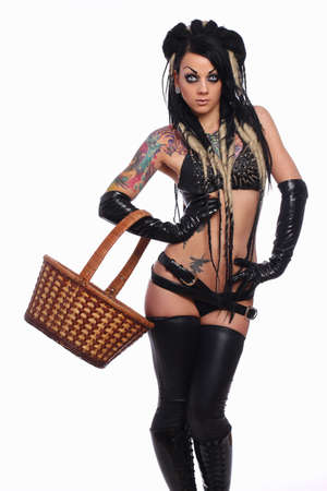 emo: Sexy emo girl in black underwear holds brown basket. Isolated on white.