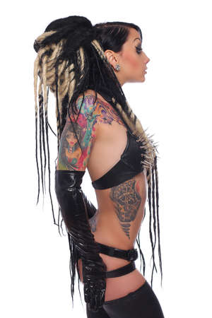 emo: Side view of tattooed emo girl in black underwear over white background.