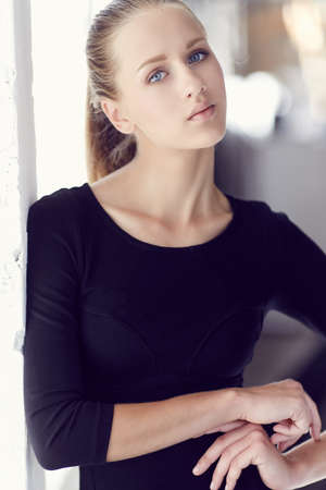 black t shirt: Portrait of slim young woman in black t shirt. Stock Photo