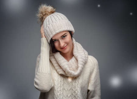 A young woman in warm sweater and winter hat.