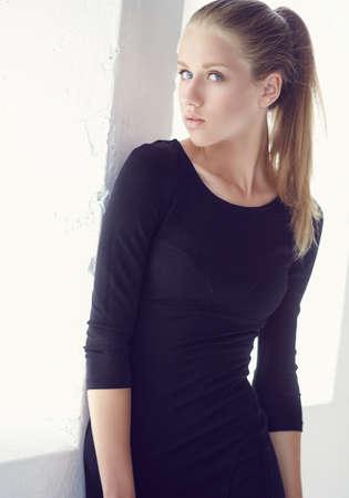 black t shirt: Portrait of young slim woman in black t shirt.