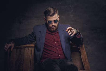 cigare: Stylish man in a suit smoking cigar. Stock Photo