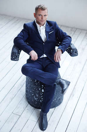 macho: Macho man in blue suit.